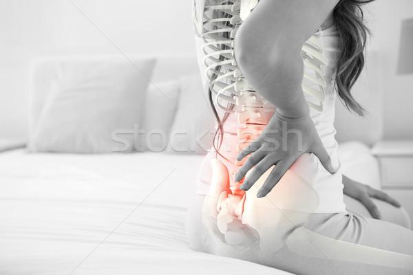 Digital composite kręgosłup kobieta domu bed Zdjęcia stock © wavebreak_media