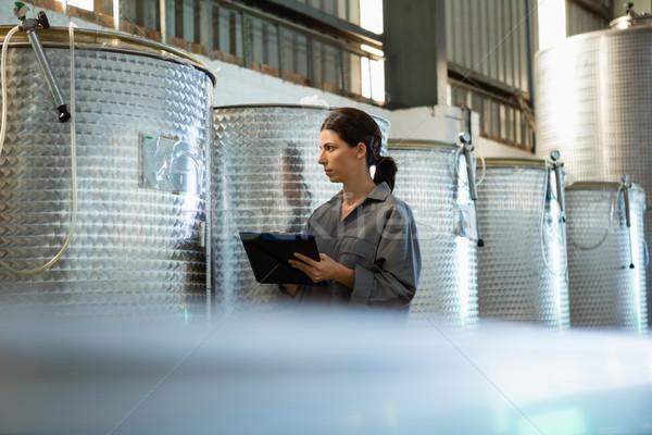 Female worker writing on clipboard in olive factory Stock photo © wavebreak_media
