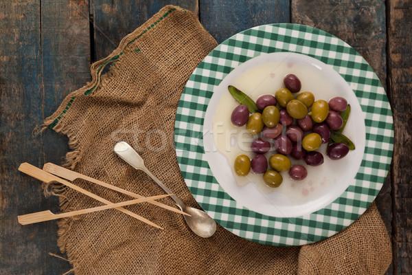 Directly above shot of olives served in plate Stock photo © wavebreak_media