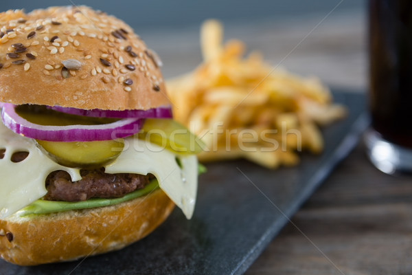 Hamburguesa con queso mesa rock negro sonriendo Foto stock © wavebreak_media