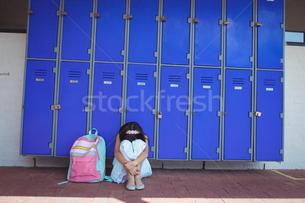 Aluna sessão calçada corredor escolas parede Foto stock © wavebreak_media