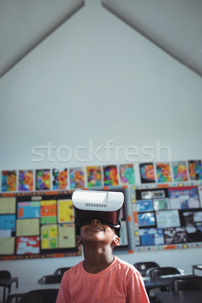 Boy with virtual reality simulator in school Stock photo © wavebreak_media