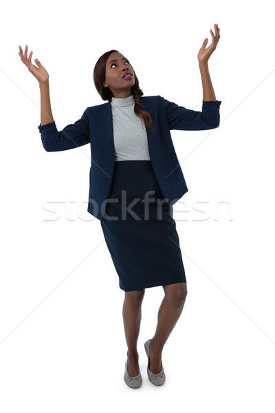 Businesswoman gesturing while tiptoeing Stock photo © wavebreak_media
