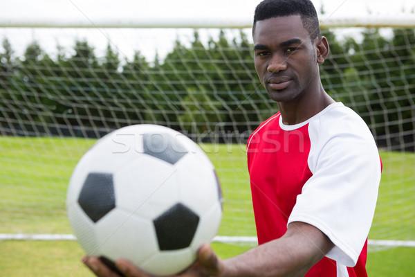 Portrait of male soccer player holding ball Stock photo © wavebreak_media