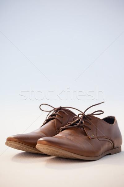 Pair of shoes against white background Stock photo © wavebreak_media