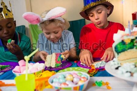 Aranyos lány tea asztal születésnapi buli otthon Stock fotó © wavebreak_media