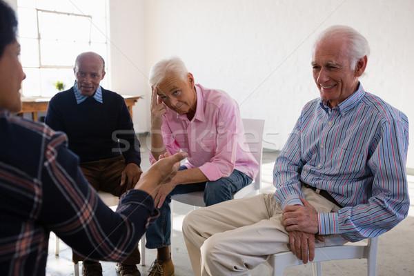 Senior friends discussing in art class Stock photo © wavebreak_media