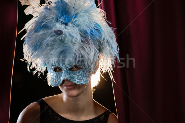 Portrait of woman wearing masquerade mask and wig in stage  Stock photo © wavebreak_media