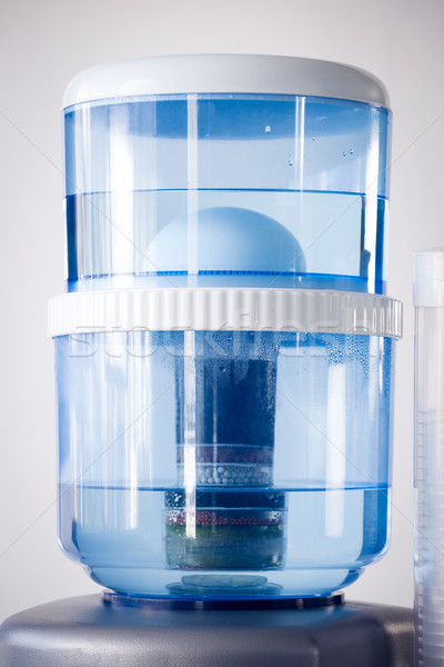 Close up of machine on water cooler against white background Stock photo © wavebreak_media