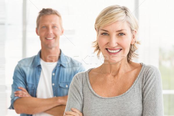 Sonriendo negocios colegas mirando cámara retrato Foto stock © wavebreak_media