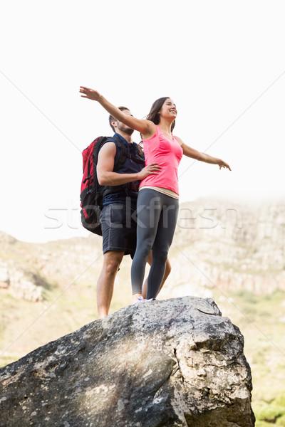 Young happy joggers posing on rock Stock photo © wavebreak_media