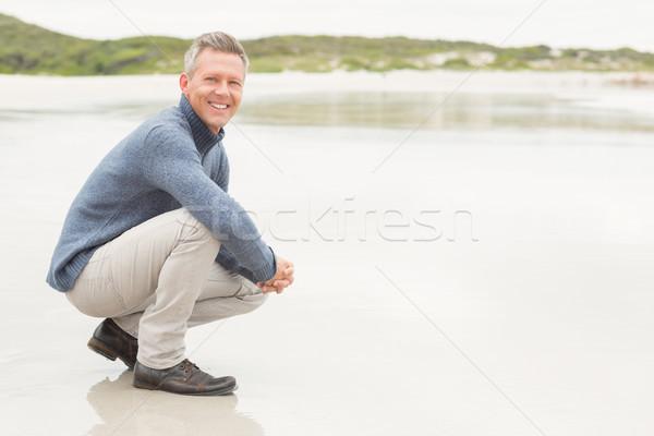 Adam aşağı kıyı plaj deniz elbise Stok fotoğraf © wavebreak_media