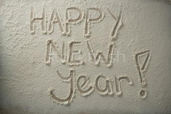 Widoku szczęśliwego nowego roku tekst mąka drewniany stół miłości Zdjęcia stock © wavebreak_media