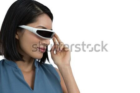 Female executive gesturing while using virtual reality headset Stock photo © wavebreak_media