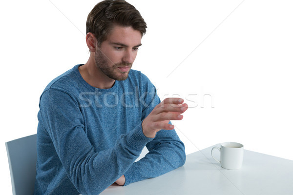 Man pretending to use an invisible screen Stock photo © wavebreak_media