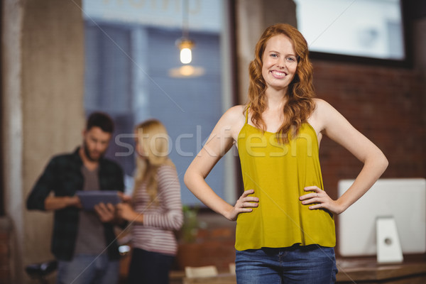 Young beautiful woman with hands on hip Stock photo © wavebreak_media
