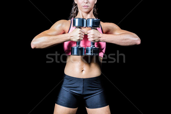 Midsection of slim woman exercising with dumbbells Stock photo © wavebreak_media