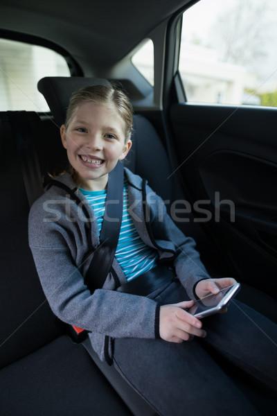 мобильного телефона назад сиденье автомобилей портрет Сток-фото © wavebreak_media