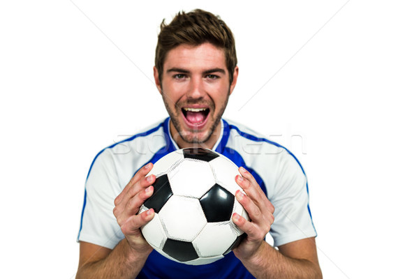 Portrait of man holding football with mouth open  Stock photo © wavebreak_media