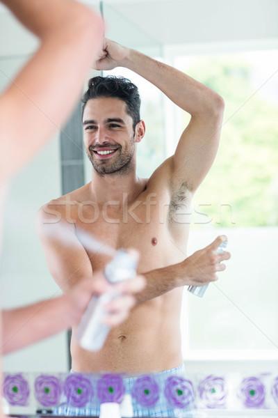 Jóképű férfi spray dezodor fürdőszoba arc férfi Stock fotó © wavebreak_media