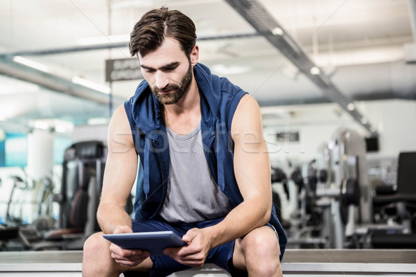 Thoughtful man using tablet Stock photo © wavebreak_media
