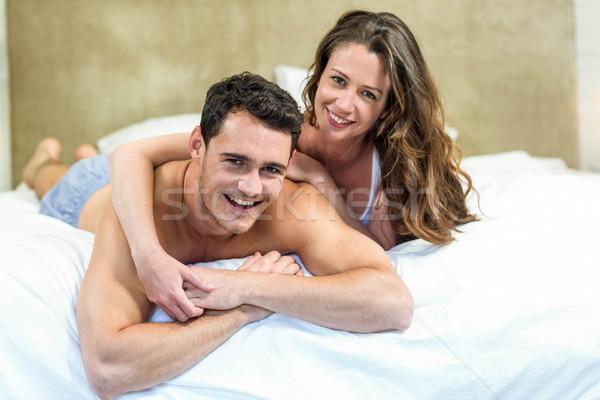 Young couple cuddling on bed Stock photo © wavebreak_media