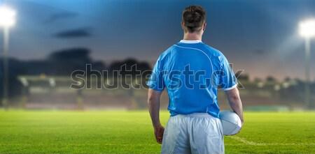 футболист Постоянный стороны бедра землю вид сзади Сток-фото © wavebreak_media