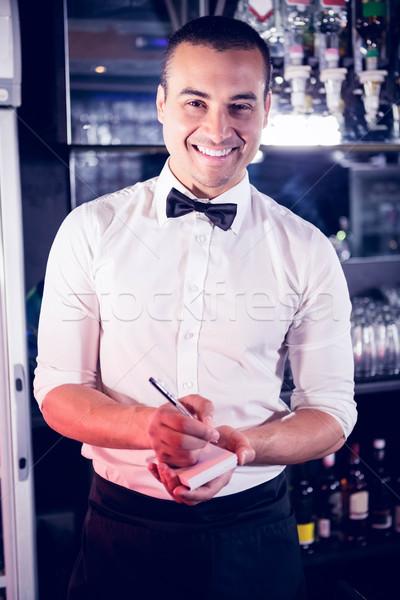 Retrato camarero escrito abajo para bar Foto stock © wavebreak_media