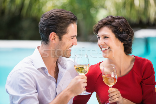 Happy couple holding white wine  Stock photo © wavebreak_media
