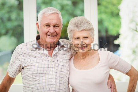Portrait of happy senior couple embracing while holding hands Stock photo © wavebreak_media