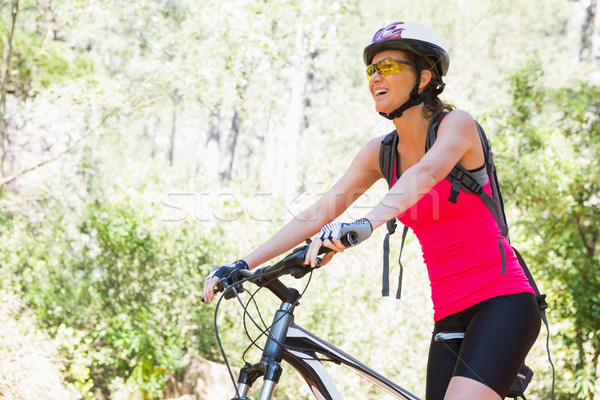 Donna sorridente ciclismo campagna donna felice natura Foto d'archivio © wavebreak_media