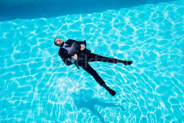Empresario piscina hombre feliz traje Foto stock © wavebreak_media