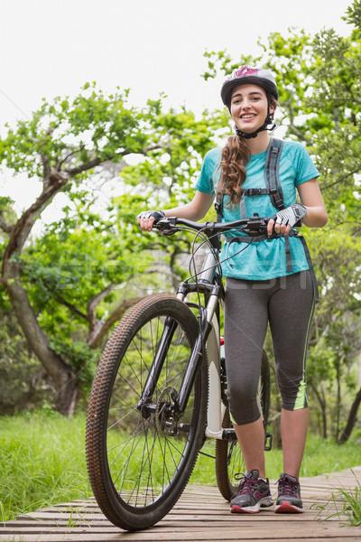 Kadın itme bisiklet gökyüzü çim Stok fotoğraf © wavebreak_media