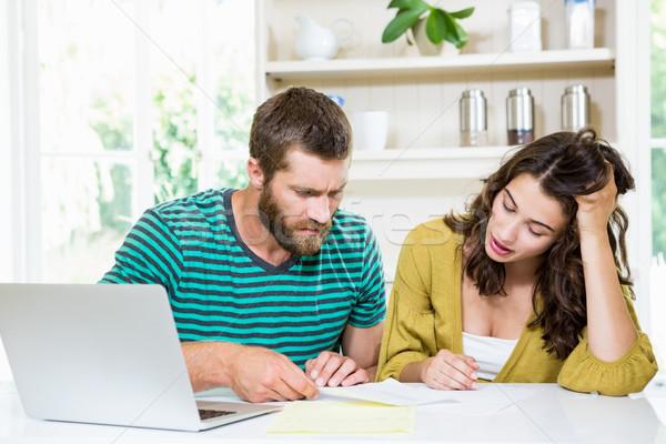 Couple checking their bills in kitchen Stock photo © wavebreak_media