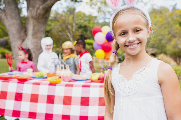Smiling girl wearing a costume during a birthday party Stock photo © wavebreak_media