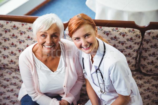 Senior woman and nurse smiling at camera Stock photo © wavebreak_media