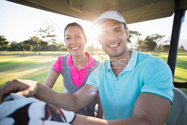 Golfer Paar Sitzung Golf Porträt Frau Stock foto © wavebreak_media