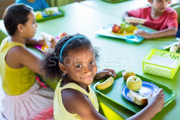 Gülen kız sınıf arkadaşları yemek portre kantin Stok fotoğraf © wavebreak_media