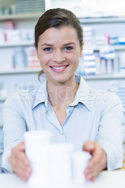 улыбаясь фармацевт медицина контейнера аптека Сток-фото © wavebreak_media