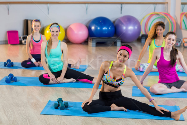Group of women performing stretching exercise Stock photo © wavebreak_media