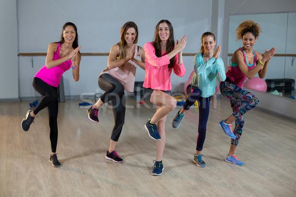 Group of women performing aerobics Stock photo © wavebreak_media