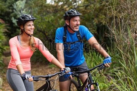 Motoros pár biciklizik vidék mosolyog fitnessz Stock fotó © wavebreak_media
