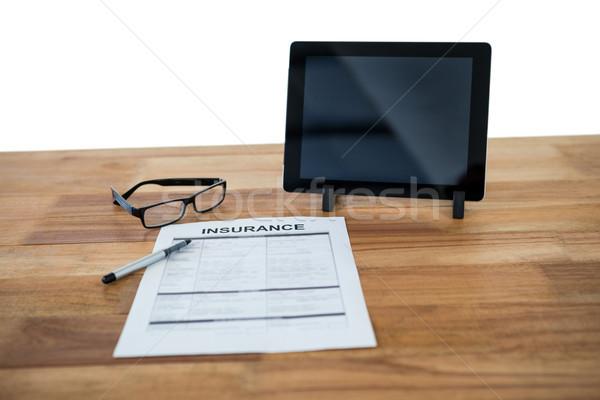 Digital tablet, insurance form, spectacle and pen on desk Stock photo © wavebreak_media