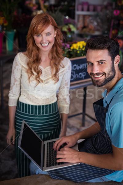 Feliz Pareja usando la computadora portátil negocios mujer Foto stock © wavebreak_media