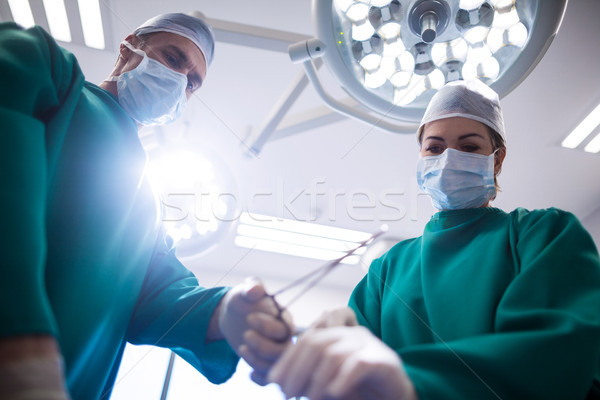Chirurghi operazione stanza ospedale donna Foto d'archivio © wavebreak_media