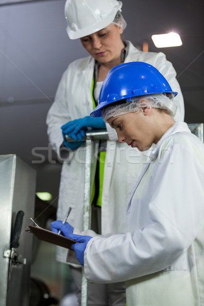 Technicians examining meat processing machine Stock photo © wavebreak_media