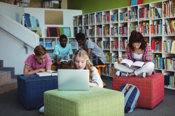 внимательный студентов изучения библиотека школы девушки Сток-фото © wavebreak_media