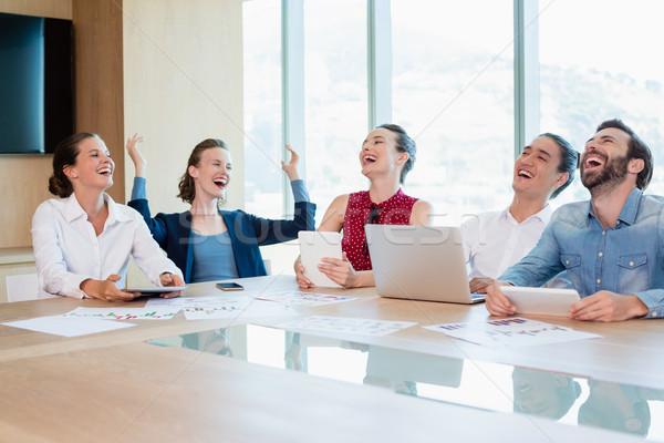 Smiling business executive having fun in conference room Stock photo © wavebreak_media