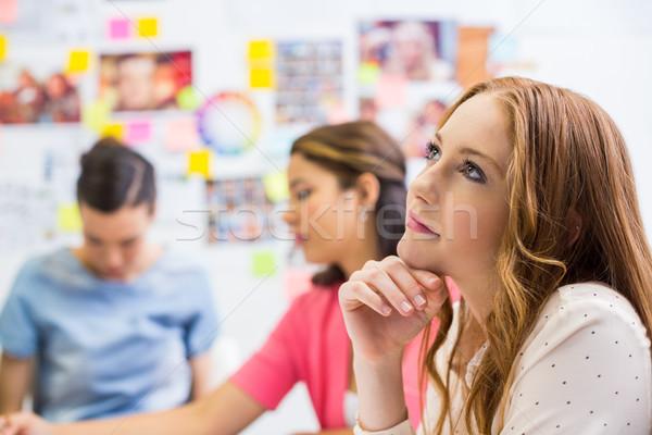Executive seduta mano mento ufficio Foto d'archivio © wavebreak_media