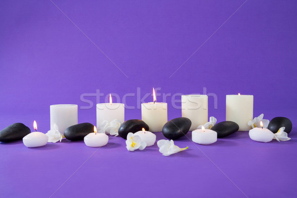Velas flores zen pedras roxo massagem Foto stock © wavebreak_media